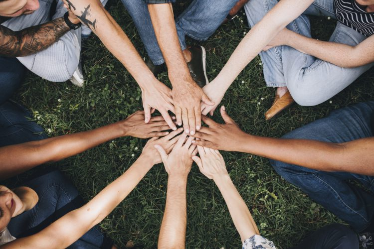 Image of community (hands stacked together)